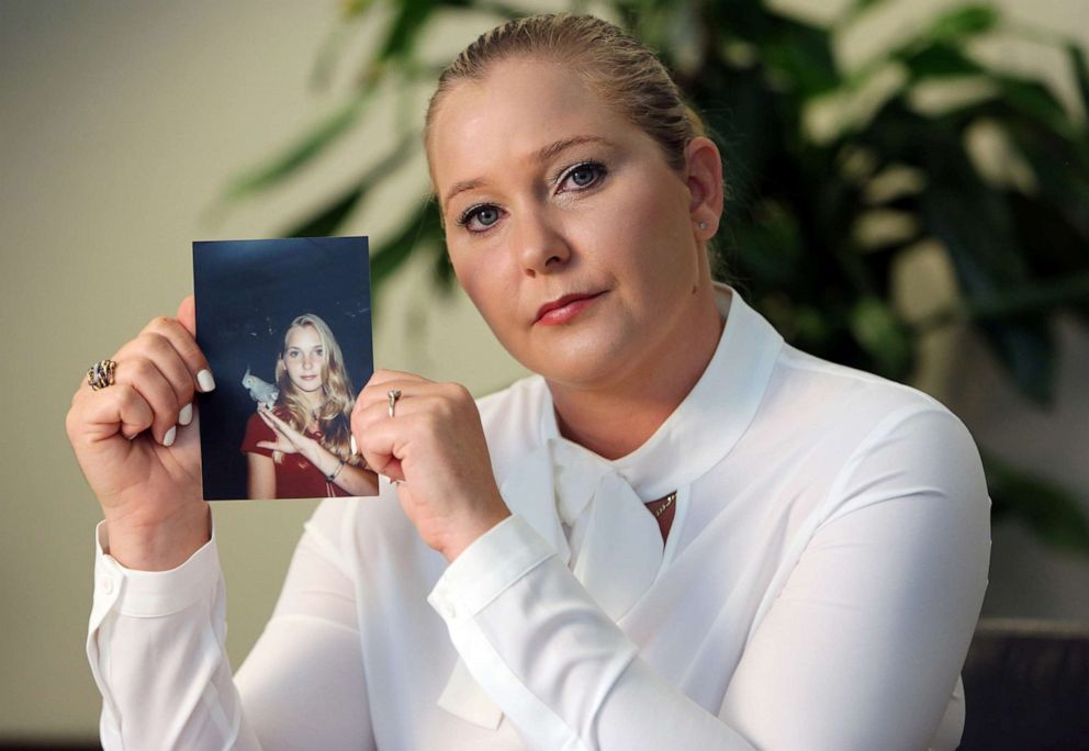PHOTO: Virginia Roberts holds a photo of herself at age 16, when she says Palm Beach multimillionaire Jeffrey Epstein began abusing her sexually.