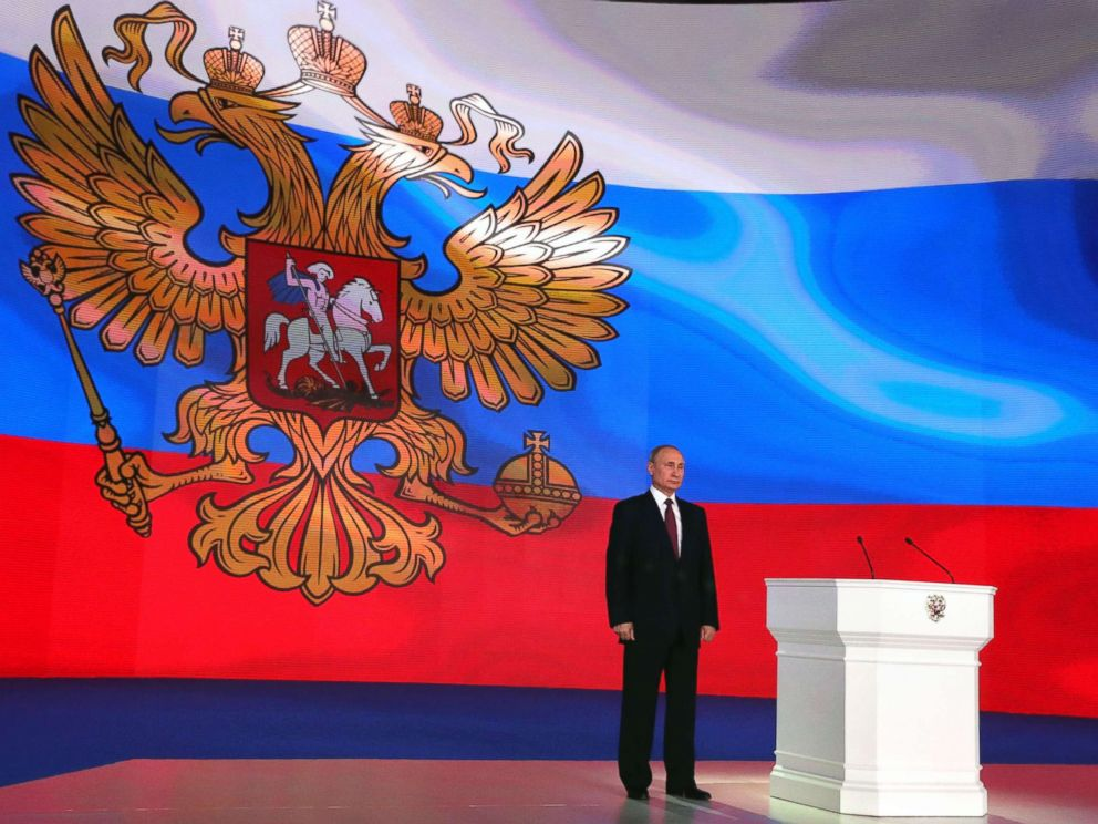 PHOTO: Russian President Vladimir Putin stands on the stage while addressing the Federal Assembly at Moscows Manezh exhibition centre, March 1, 2018.