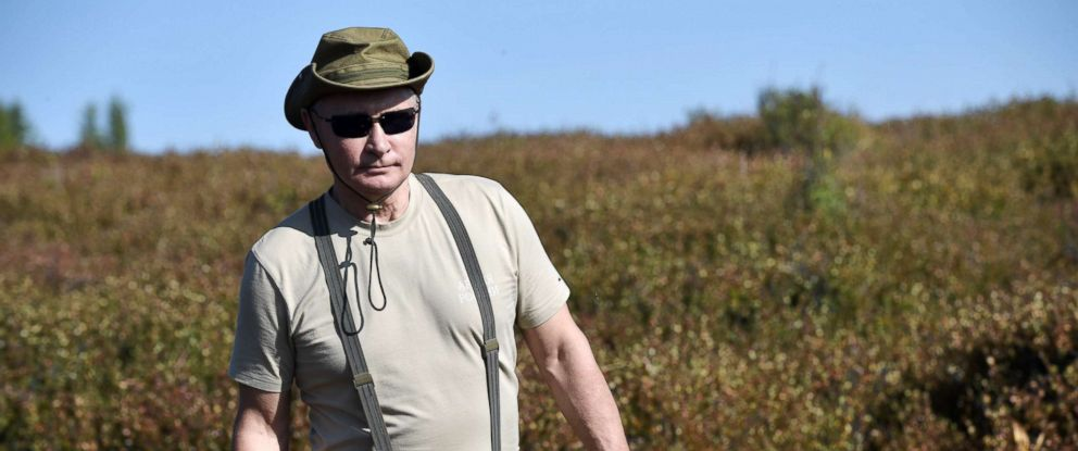 PHOTO: President Vladimir Putin walks with a mushroom in his hand during a short vacation in the remote Tuva region in southern Siberia on Aug. 26, 2018, in a photo released by the Russian state news agency.