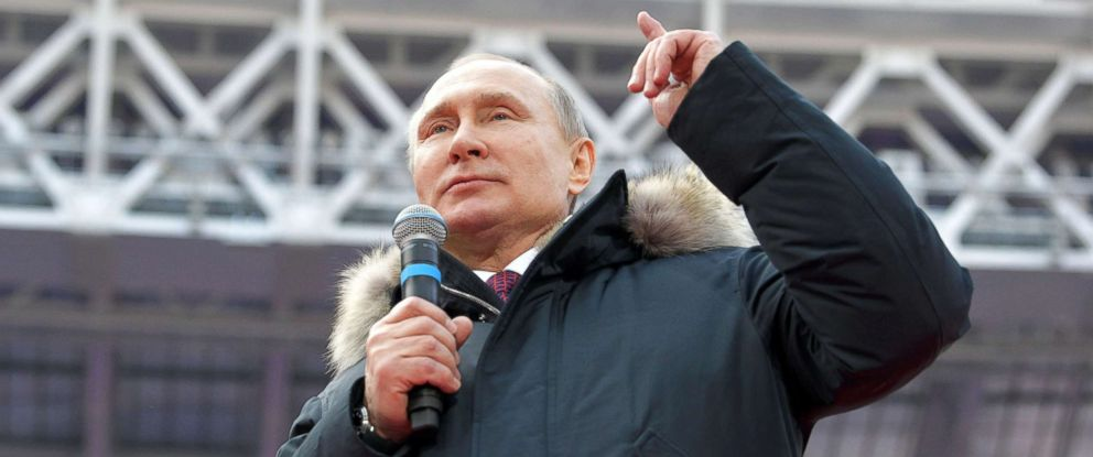 PHOTO: Russian President Vladimir Putin delivers a speech during a rally to support his bid in the upcoming presidential election, at Luzhniki Stadium in Moscow, March 3, 2018.
