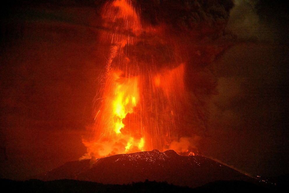 PHOTO: Shinmoedake peak spews molten lava as it erupts between Miyazaki and Kagoshima prefectures, southwestern Japan, in a photo taken by a remote camera and released by Kyodo News, April 5, 2018.
