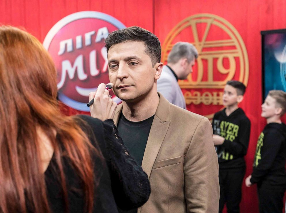 PHOTO: Ukrainian presidential candidate Volodymyr Zelenskiy has makeup applied backstage during the filming of his comedy show Liga Smeha (League of Laughter) on March 19, 2019 in Kiev, Ukraine.