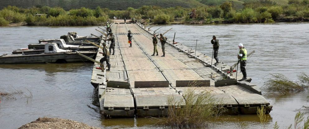 PHOTO: The Russian Army Corps of Engineers provide low water crossing on the Onon river for military equipment during the Vostok 2018 (East 2018) military maneuvers in Zabaykalsky Kray, Russia, Sept. 12, 2018.
