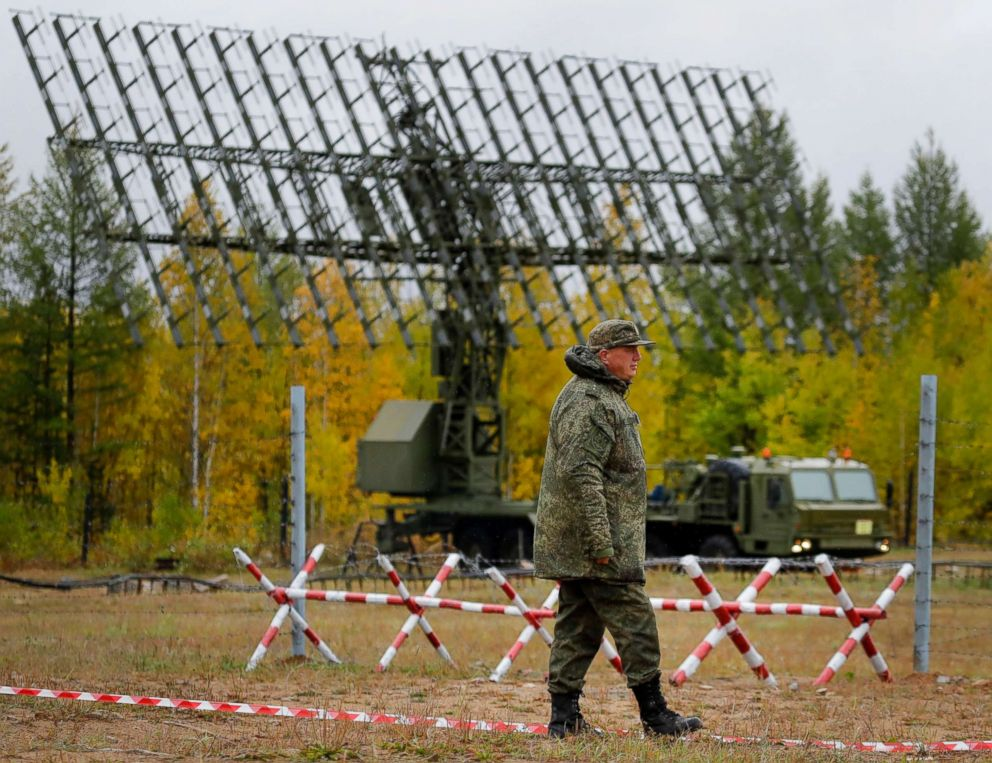 PHOTO: A Russian walks past a Nebo-M radar deployed in a forest during the military exercises Vostok 2018 in Eastern Siberia, Russia, Sept. 12, 2018.