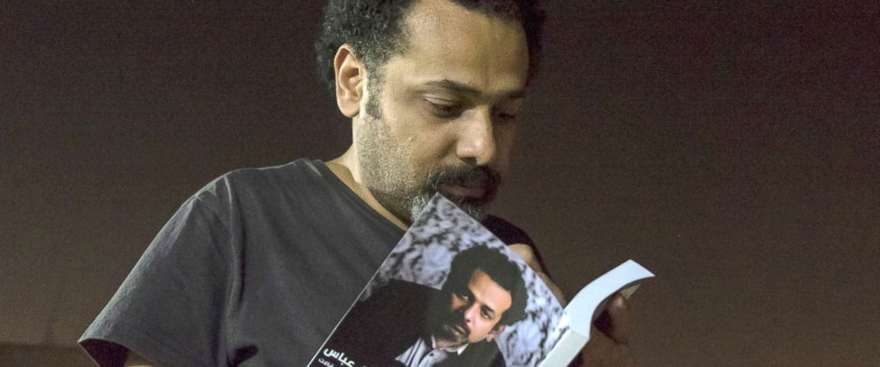 "PHOTO: In this June 9, 2017 file photo provided by Roger Anis, prominent activist and blogger Wael Abbas signs a copy of his book, ""The theory of leaving the bowl,""? in Cairo."