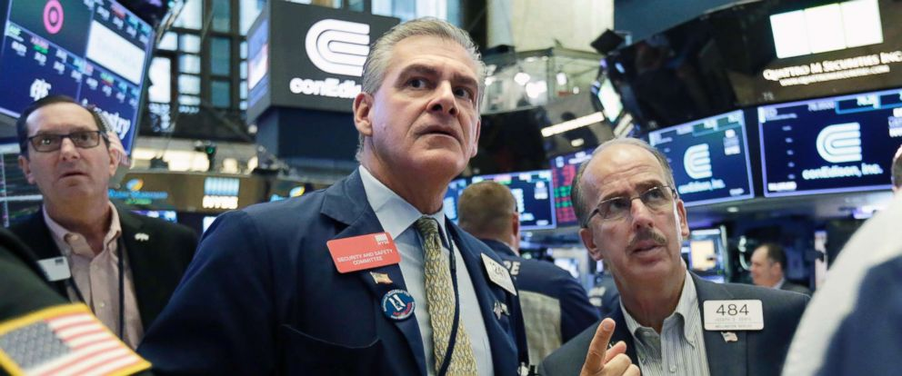 PHOTO: Traders Richard Deviccaro, center, and Joseph Dente, right, work on the floor of the New York Stock Exchange, Aug. 10, 2018.