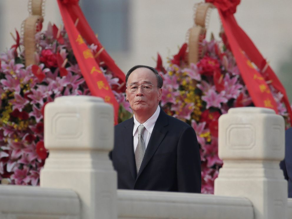 PHOTO: Chinas Politburo Standing Committee member Wang Qishan, the head of Chinas anti-corruption watchdog, attends a tribute ceremony in front of the Monument to the Peoples Heroes at Tiananmen Square, in Beijing, Sept. 30, 2017.