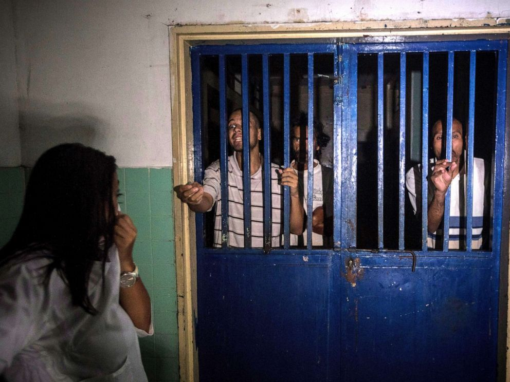 PHOTO: Mental health patients stand behind the bars of their room at the Caracas Psychiatric Hospital, in Caracas, Venezuela, July 14, 2019.