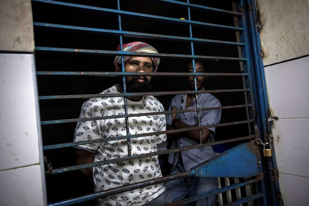 PHOTO: Two mental health patients look behind the bars of their room at the Caracas Psychiatric Hospital, in Caracas, Venezuela, July 14, 2019.