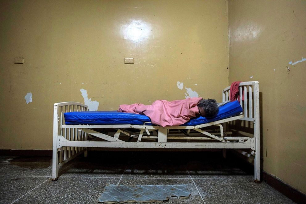 PHOTO: A mental health patient lies on a bed at the Caracas Psychiatric Hospital, in Caracas, Venezuela, July 14, 2019.