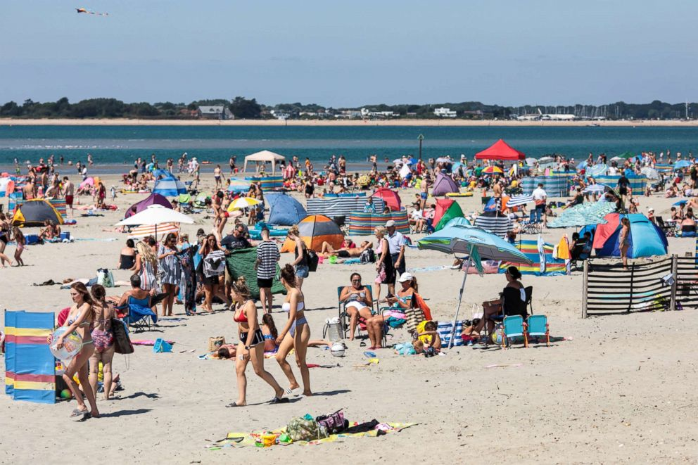 PHOTO: Beachgoers gather on West Wittering Beach during hot weather, July 23, 2018, in Chichester, England.
