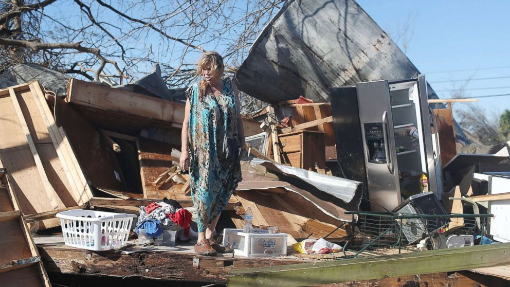 Kathy Coy stands among what is left of her home after Hurricane Michael destroyed it on Oct. 11, 2018 in Panama City, Florida. She said she was in the home when it was blown apart and is thankful to be alive.