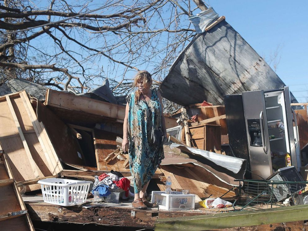 PHOTO: Kathy Coy stands among what is left of her home after Hurricane Michael destroyed it on Oct. 11, 2018 in Panama City, Florida. She said she was in the home when it was blown apart and is thankful to be alive.