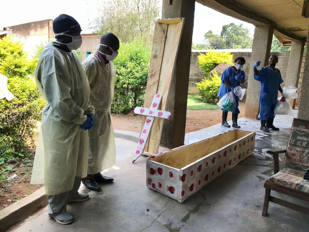 PHOTO: Health workers at Mangina hospital prepare to conduct a safe burial, Aug. 15, 2018.