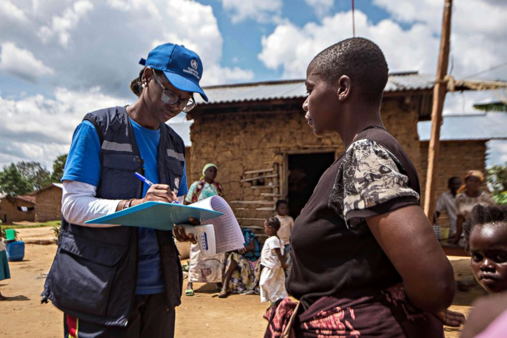 PHOTO: WHO Epidemiology Team Leader Dr. Marie-Roseline Darnycka Bélizaire interviews a woman as part of the process of Ebola contact tracing on Aug. 26, 2018, in Mangina, Democratic Republic of the Congo.