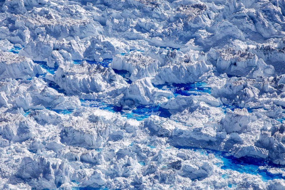 PHOTO: Meltwater pools are seen on top of the Helheim glacier near Tasiilaq, Greenland, June 19, 2018.