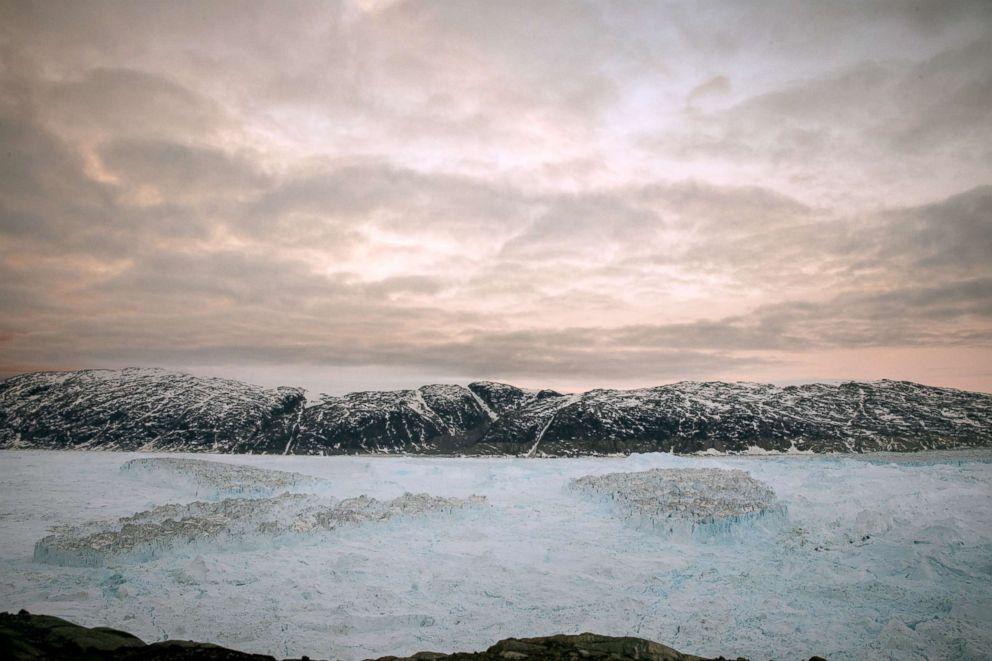PHOTO: Tabular icebergs float in the Sermilik Fjord after a large calving event at the Helheim glacier near Tasiilaq, Greenland, June 23, 2018.