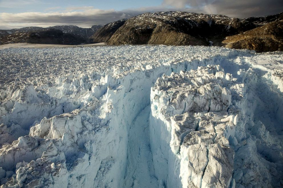 PHOTO: A large crevasse forms near the calving front of the Helheim glacier near Tasiilaq, Greenland, June 22, 2018.