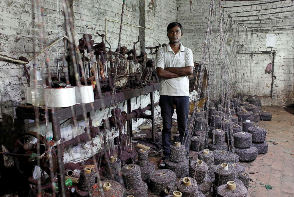 PHOTO: Ram Pratap, who lost his job as a powerloom operator earlier this year, poses for a picture inside a weaving factory where he used to work, in Panipat, India, Aug. 24, 2018.