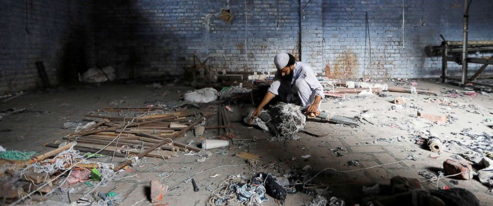 PHOTO: A scrap dealer searches for useful material at a weaving factory, that was shut a year ago, in Panipat, India, Aug. 29, 2018.