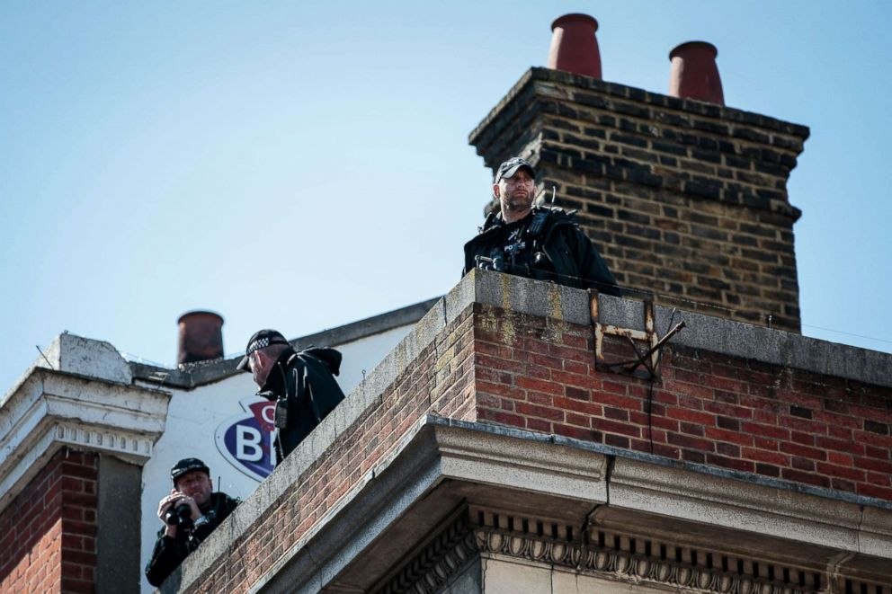 PHOTO: Police officers look on from a roof during a dress rehearsal of the wedding of Prince Harry and Meghan Markle outside Windsor Castle, May 17, 2018 in Windsor, England.