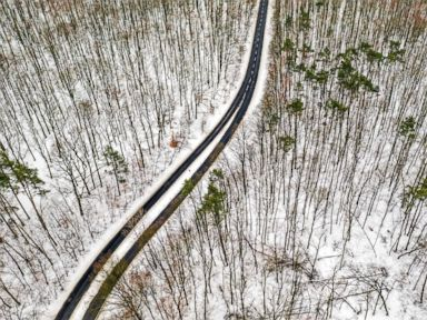 PHOTO: A road in the Lagiewnicki Forest in Lodz, Poland, is covered in snow, Jan. 9, 2019.