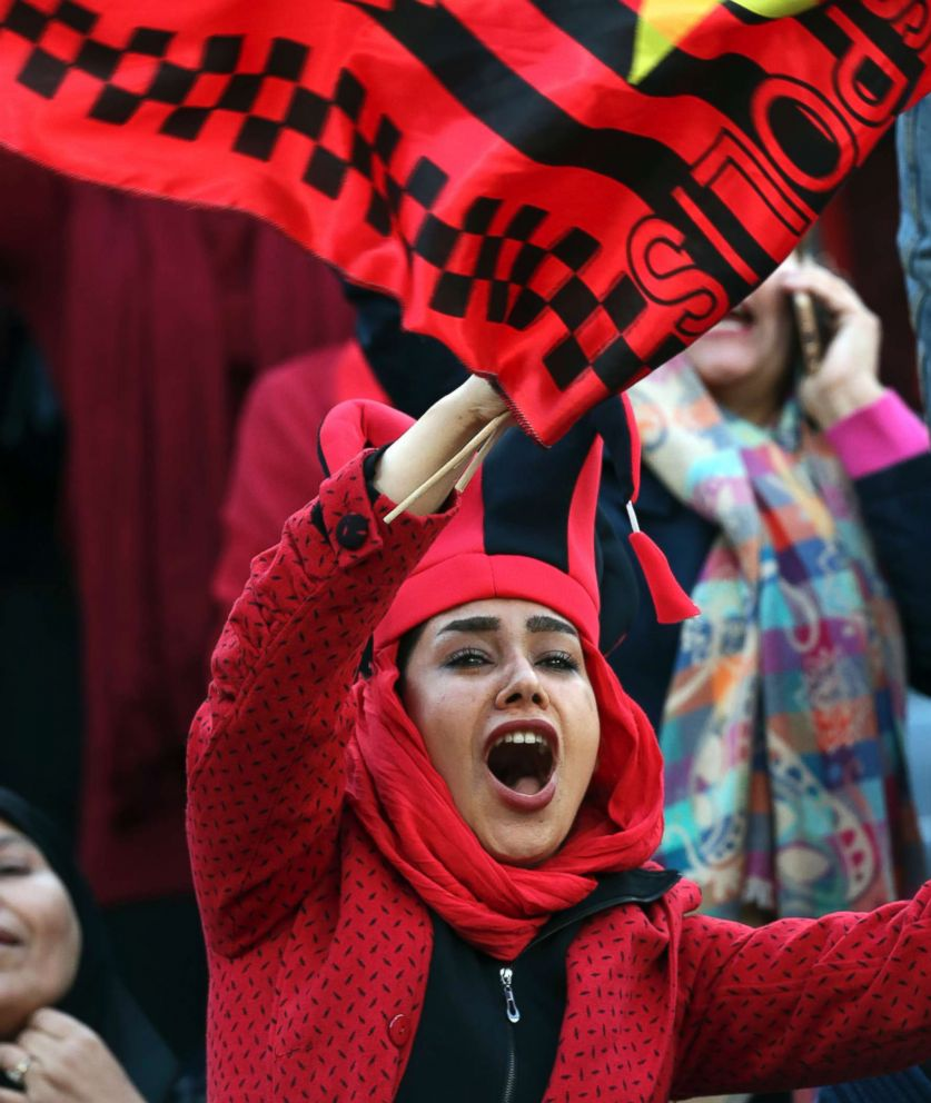 PHOTO: A female Iranian spectator cheers as she waves a flag of Persepolis prior to the start their soccer match with Japans Kashima Antlers at the Azadi stadium in Tehran, Iran, Nov. 10, 2018.