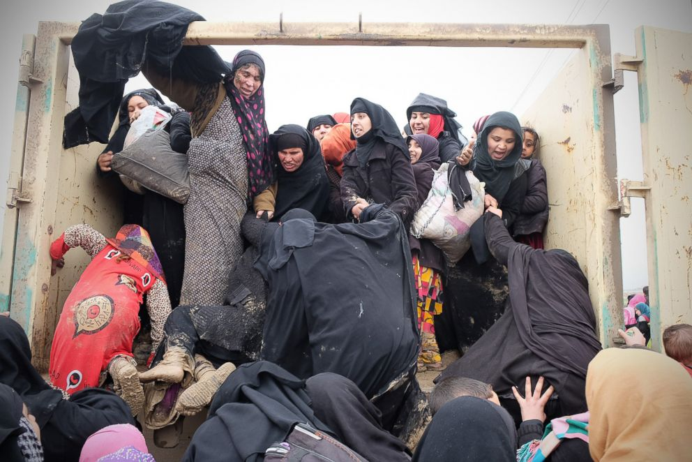 PHOTO: A group of Iraqi women are fleeing IS attacks during the siege of Mosul.