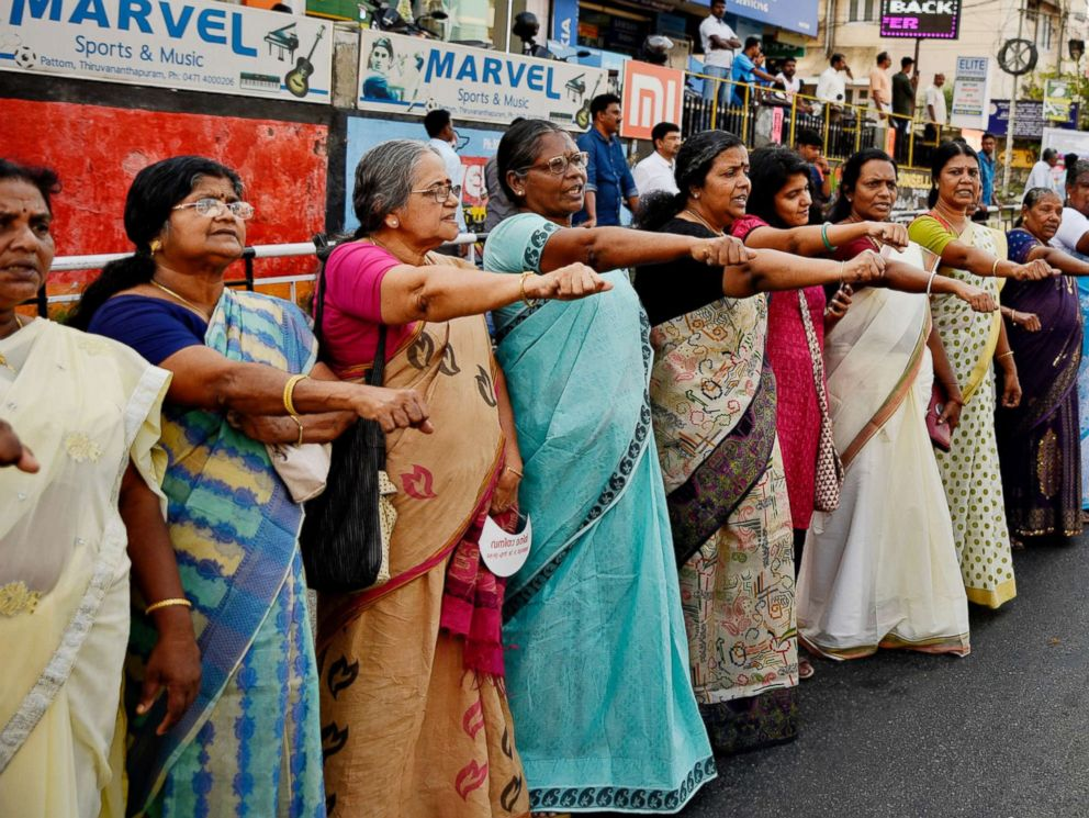 PHOTO: Women raise their hands to take a pledge to fight gender discrimination as they form part of a hundreds kilometer long womens wall in Thiruvananthapuram, in the southern Indian state of Kerala, Jan. 1, 2019.