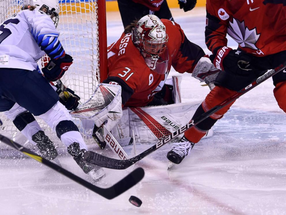 PHOTO: Canadas Genevieve Lacasse defends her goal in the womens preliminary round ice hockey match between the U.S. and Canada during the Pyeongchang 2018 Winter Olympic Games in Gangneung on Feb. 15, 2018.