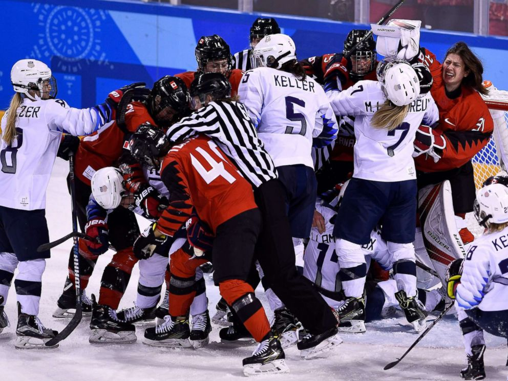 PHOTO: Players pile up on the Canadian goal in the womens preliminary round ice hockey match between the U.S. and Canada during the Pyeongchang Winter Olympic Games at the Kwandong Hockey Centre in Gangneung, Feb. 15, 2018.