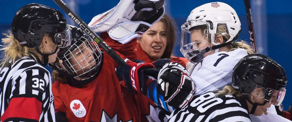 PHOTO: Canada forward Marie-Philip Poulin battles with United States forward Monique Lamoureux-Morando during the third period of a preliminary round womens hockey game at the 2018 Winter Olympics in Gangneung, South Korea, Feb. 15, 2018.