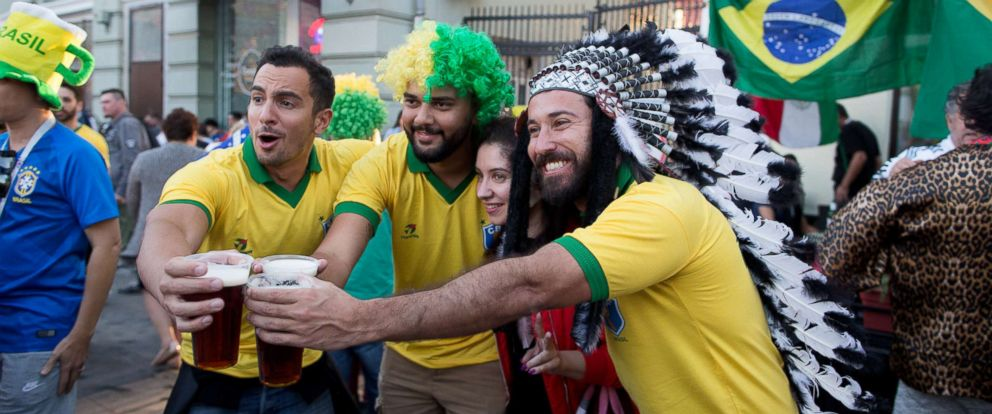 PHOTO: Supporters of the Brazil soccer team toast with pints of beer as they pose for a photograph in Moscow, June 15, 2018.