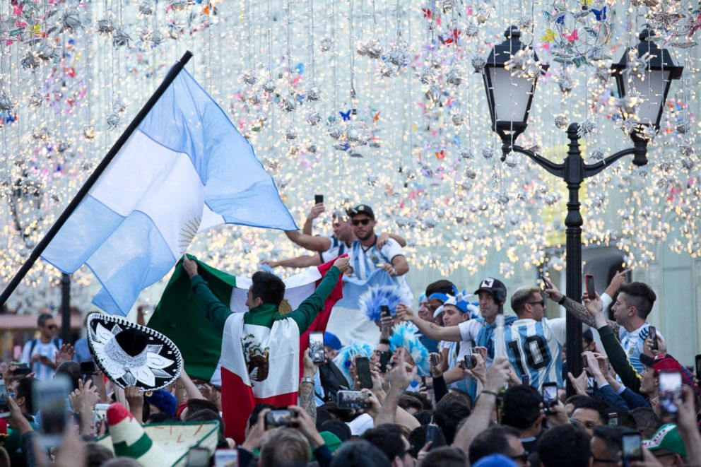 PHOTO: Supporters of the Argentina and Mexico soccer teams wave flags as they celebrate among crowds in Moscow, June 15, 2018.  World Cup fans drinking Moscow dry, straining bars' beer supplies world cup fans 02 gty jef 180620 hpEmbed 3x2 992