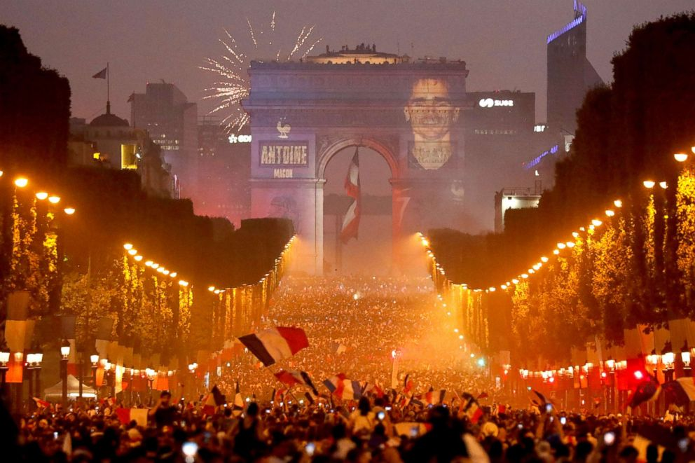 PHOTO: A giant picture of Frances Antoine Griezmann is seen on the Arc de Triomphe as France fans celebrate on the Champs-Elysees Avenue after France won the Soccer World Cup final, July 15, 2018, in Paris.