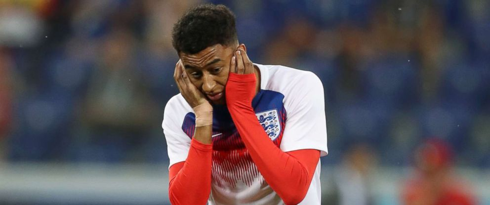 PHOTO: Jesse Lingard of England reacts after an insect lands on him ahead of the 2018 FIFA World Cup Russia group G match between Tunisia and England at Volgograd Arena on June 18, 2018 in Volgograd, Russia.