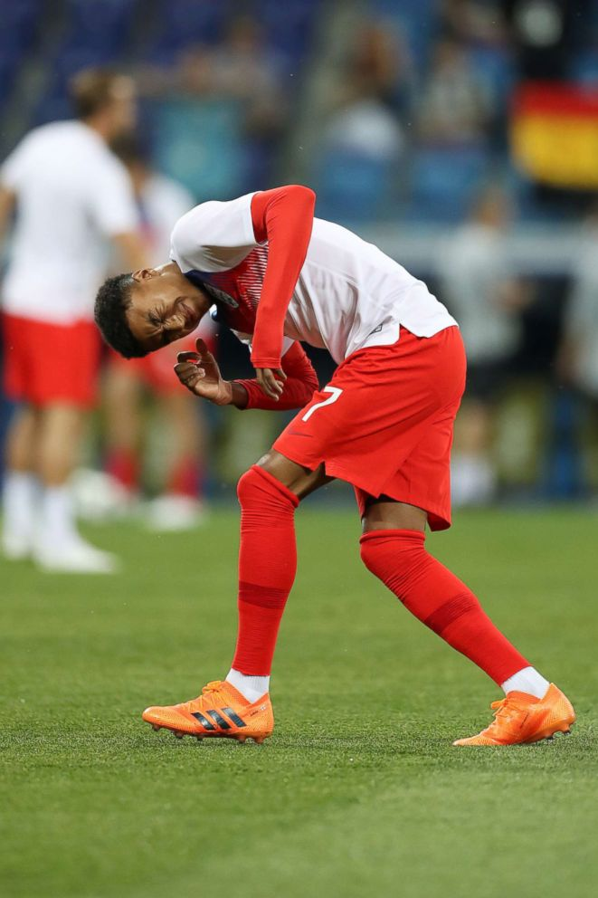 PHOTO: Jesse Lingard of England reacts after an insect lands on him ahead of the 2018 FIFA World Cup Russia group G match between Tunisia and England at Volgograd Arena on June 18, 2018 in Volgograd, Russia.  Russian city sprays vanilla to try to repel clouds of gnats before World Cup game world cup insects 3 gty jt 180622 hpEmbed 2x3 992