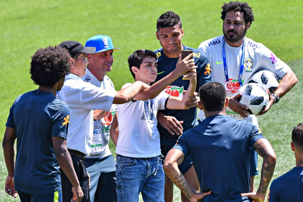 PHOTO: A fan takes a picture with Brazils Casemiro during a training session at Sochi Municipal Stadium in Sochi, Russia on June 12, 2018, ahead of the Russia 2018 World Cup.