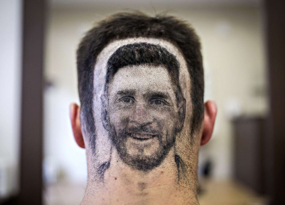 PHOTO: A soccer fan sports a hair tattoo showing the portrait of Argentinian football player Lionel Messi at a hair salon in Novi Sad, Serbia on June 10, 2018.