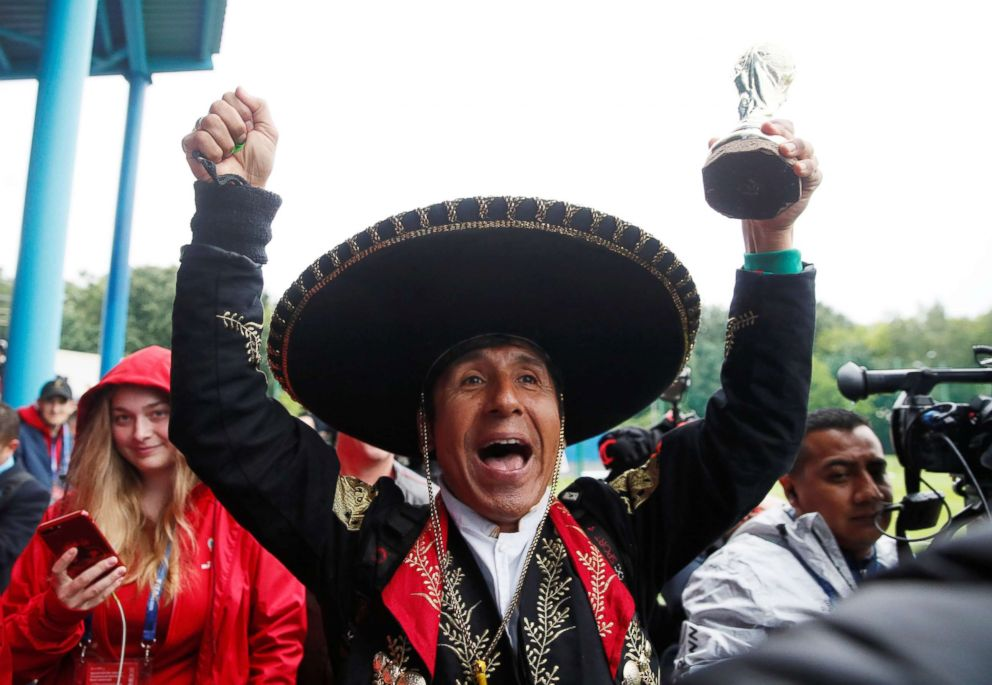 PHOTO: A Mexico fan holds a toy trophy at FC Strogino Stadium on June 12, 2018, ahead of the of the World Cup in Moscow.