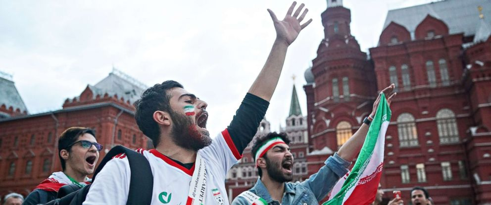 PHOTO: Soccer fans from Iran sing songs and wave flags near Red Square ahead of the World Cup on June 11, 2018, in Moscow.
