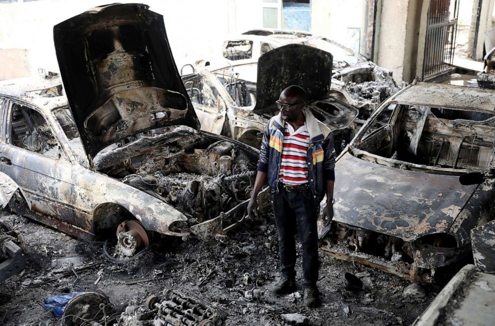 PHOTO: Nigerian entrepreneur Basil Onibo, one of the victims of the latest spate of xenophobic attacks looks at the burnt out cars at his dealership in Johannesburg, South Africa, Sept. 5, 2019.