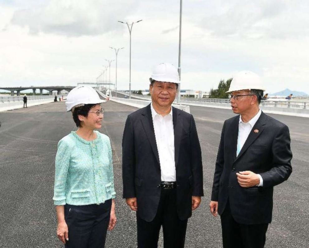 PHOTO: President Xi Jinping (C) is briefed by the Secretary for Transport and Housing, Mr Frank Chan Fan (R) on the Hong Kong section of the Hong Kong-Zhuhai-Macao Bridge (HZMB) during his inspection of the HZMB Hong Kong Link Road, July 1, 2018.