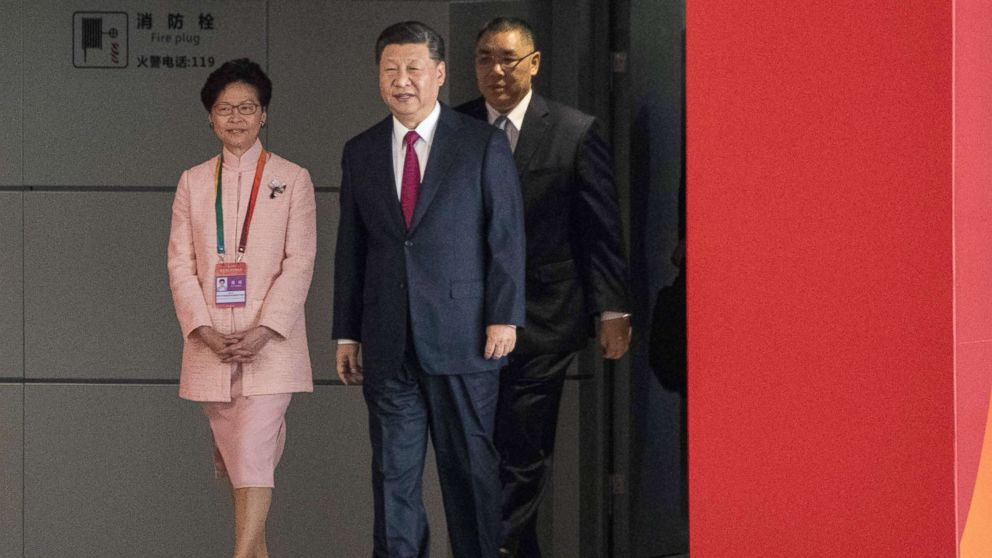 Hong Kong's Chief Executive Carrie Lam and China's President Xi Jinping arrive at the opening ceremony of the Hong Kong-Zhuhai-Macau Bridge at the Zhuhai Port terminal, Oct. 23, 2018.