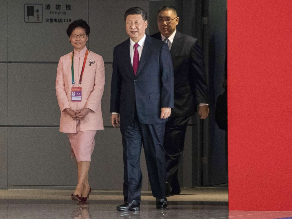 PHOTO: Hong Kongs Chief Executive Carrie Lam and Chinas President Xi Jinping arrive at the opening ceremony of the Hong Kong-Zhuhai-Macau Bridge at the Zhuhai Port terminal, Oct. 23, 2018.