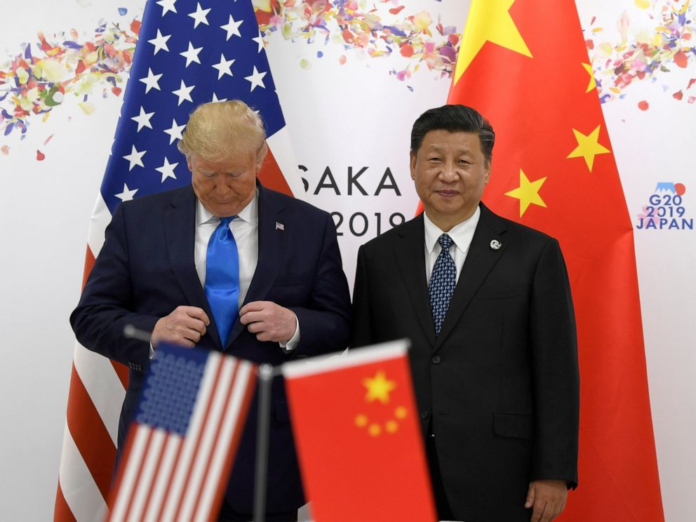 PHOTO: President Donald Trump adjusts his jacket as he poses for a photo with Chinese President Xi Jinping during a meeting on the sidelines of the G-20 summit in Osaka, Japan, Saturday, June 29, 2019.