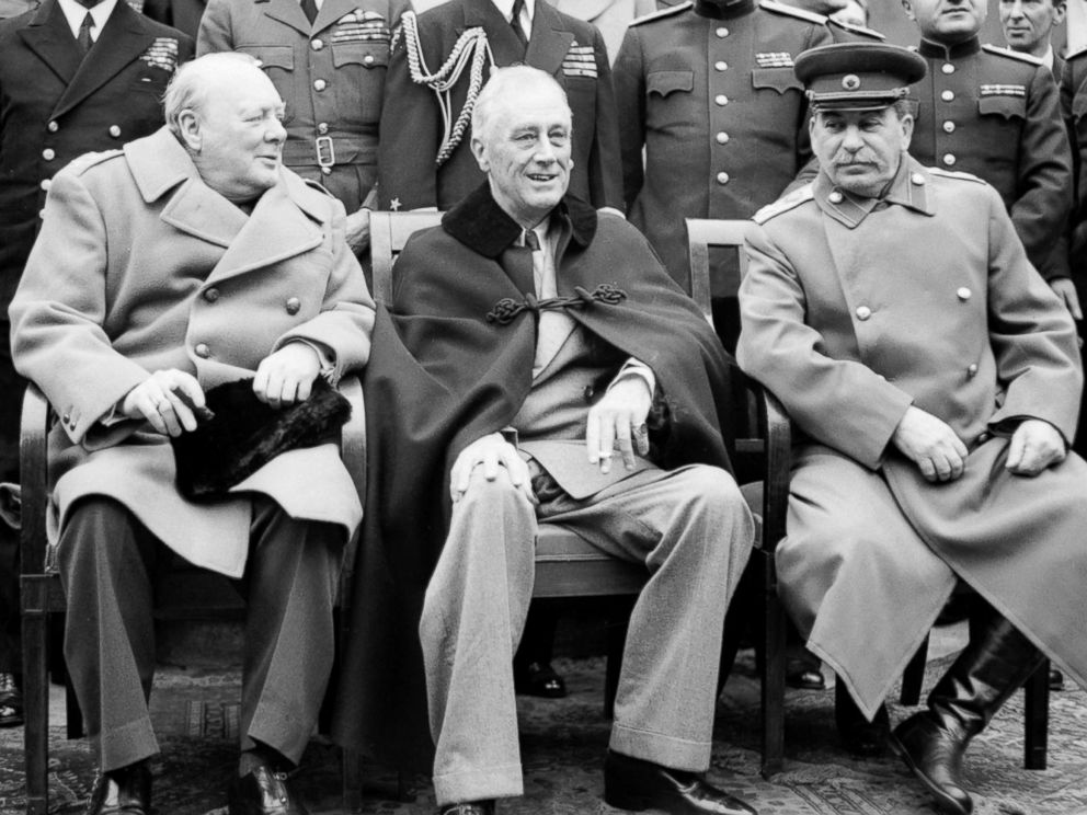 PHOTO: Winston Churchill, Franklin D Roosevelt and Jospeh Stalin sit for photographs during the Yalta Conference in February 1945.