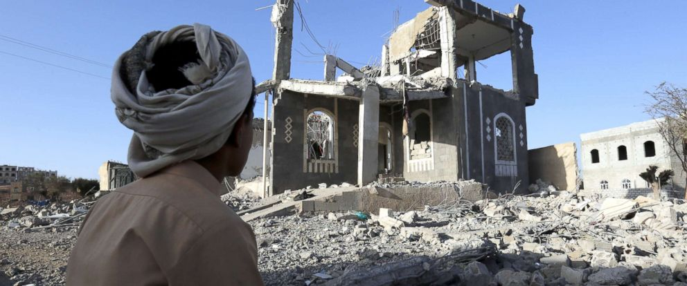 PHOTO: A Yemeni sits in front of a building allegedly destroyed by recent airstrikes, on the third anniversary of the Saudi-led military campaign on Yemen, in Sanaa, Yemen, March 25, 2018.