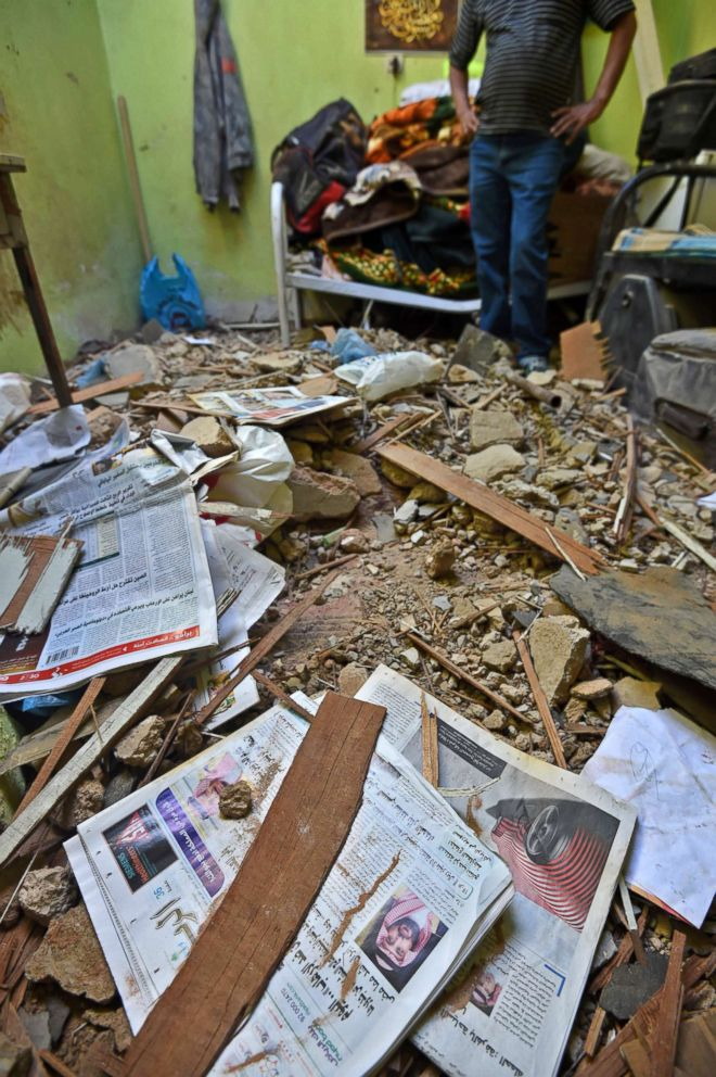 PHOTO: A picture taken March 26, 2018 in Um Al-Hammam district in Riyadh shows rubble, debris, and old newspapers scattered over a home hit by falling shrapnel from Yemeni rebel missiles that were intercepted over the Saudi capital.
