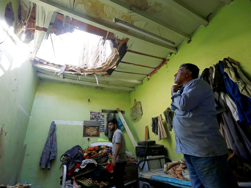 PHOTO: People check the damage after debris from ballistic missiles fired by Yemens Houthi militia fell onto a house in Riyadh, Saudi Arabia, March 26, 2018.